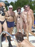 Big group of family nudists having party in the pool
