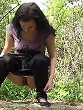 Amateur cutie filmed pissing in a forest